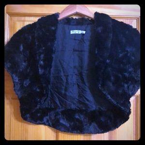 Black fauxfur bolero lined neverworn but w/o tags
